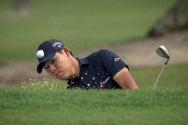 Si Woo Kim, of South Korea, hits out of the bunker on the second hole during the final round of the RBC Heritage golf tournament in Hilton Head Island, S.C., Sunday, April 15, 2018. (AP Photo/Stephen B. Morton)