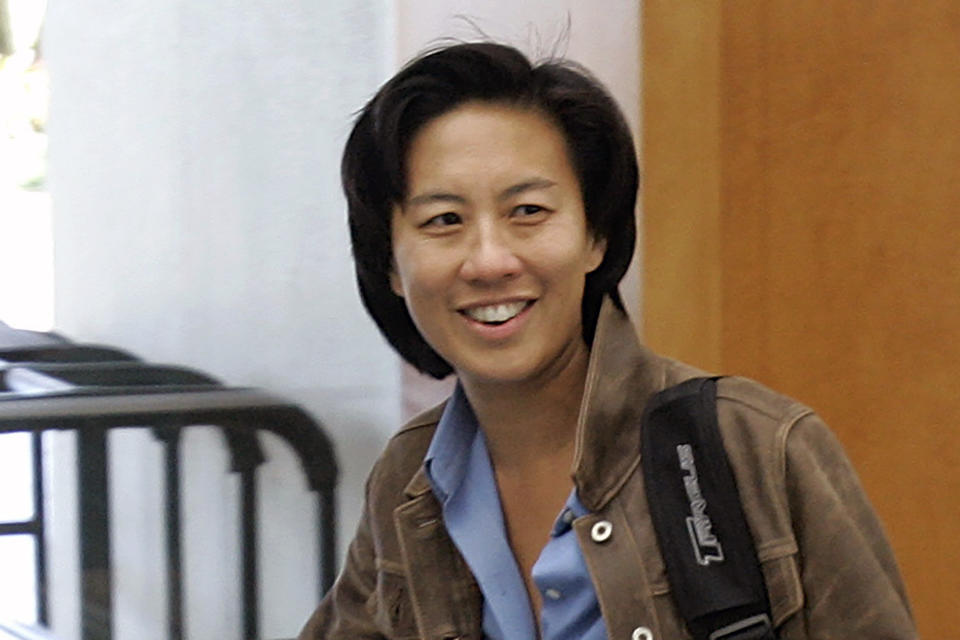 FILE - In this Nov. 5, 2007, file photo, then-Los Angeles Dodgers assistant general manager Kim Ng walks through a hotel lobby during the first day of the Major League Baseball annual general managers meetings in Orlando, Fla. As baseball's first female GM, for the Miami Marlins, Ng can bask in a breakthrough achievement that's all the more admirable because she was turned down for a similar job by at least five other teams over the past 15 years. (AP Photo/John Raoux, File)