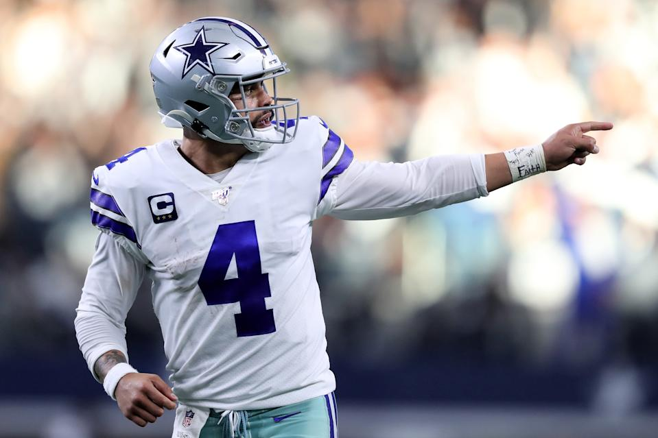 ARLINGTON, TEXAS - DECEMBER 29: Dak Prescott #4 of the Dallas Cowboys celebrates after scoring a touchdown in the second quarter against the Washington Redskins in the game at AT&T Stadium on December 29, 2019 in Arlington, Texas. (Photo by Tom Pennington/Getty Images)