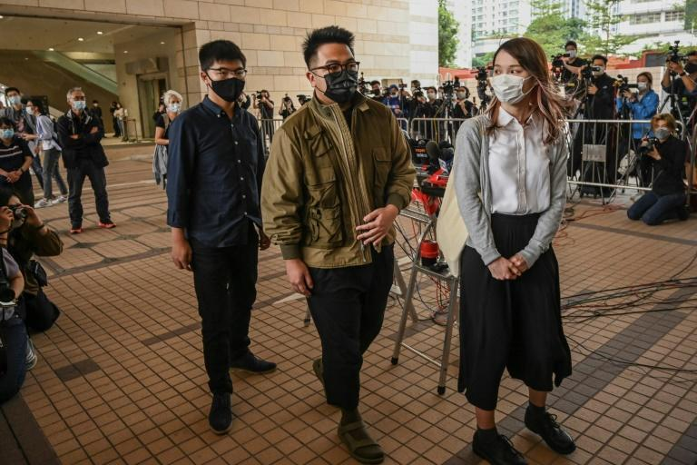 """Pro-democracy activists (L-R) Joshua Wong, Ivan Lam and Agnes Chow pleaded guilty to inciting an """"illegal assembly"""" last year"""
