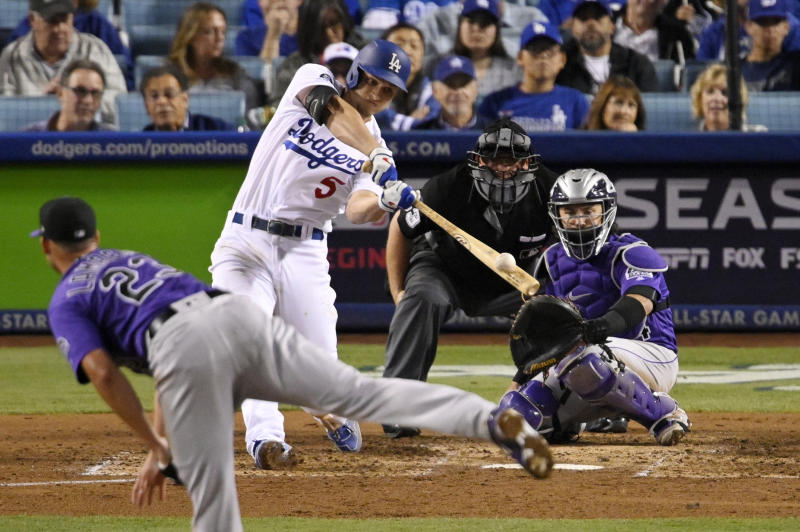 Los Angeles Dodgers' Corey Seager hits a solo home run off Colorado Rockies starting pitcher Peter Lambert, left, during the fourth inning of a baseball game Friday, Sept. 20, 2019, in Los Angeles. (AP Photo/Mark J. Terrill)