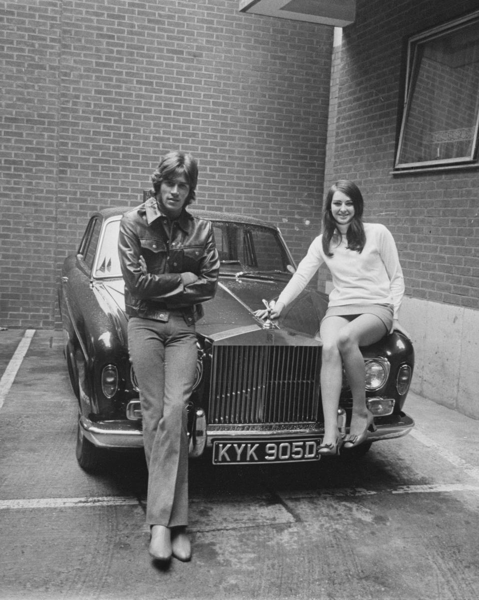 British singer-songwriter Barry Gibb and his girlfriend Linda Gray sit on Gibb's Roll Royce, UK, 28th October 1968.(Photo by Larry Ellis/Daily Express/Hulton Archive/Getty Images)
