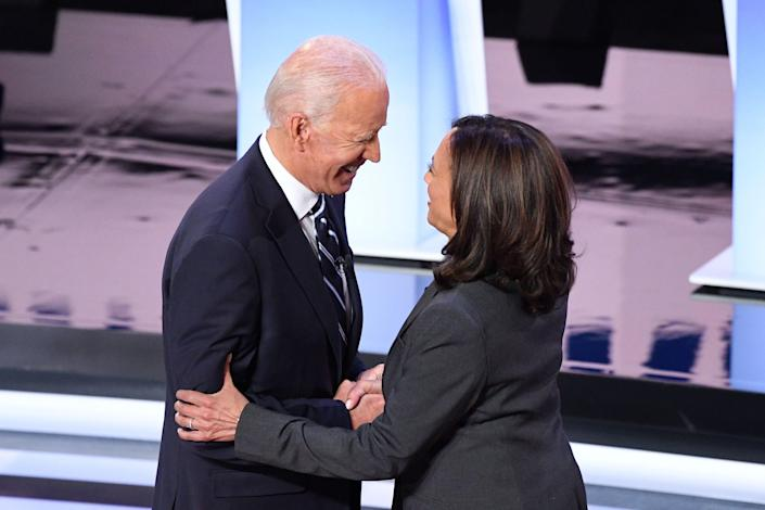 Former Vice President Joe Biden and Sen. Kamala Harris greet each other ahead of the second round of the second Democratic primary debate of the 2020 presidential campaign season at the Fox Theatre in Detroit on July 31, 2019.