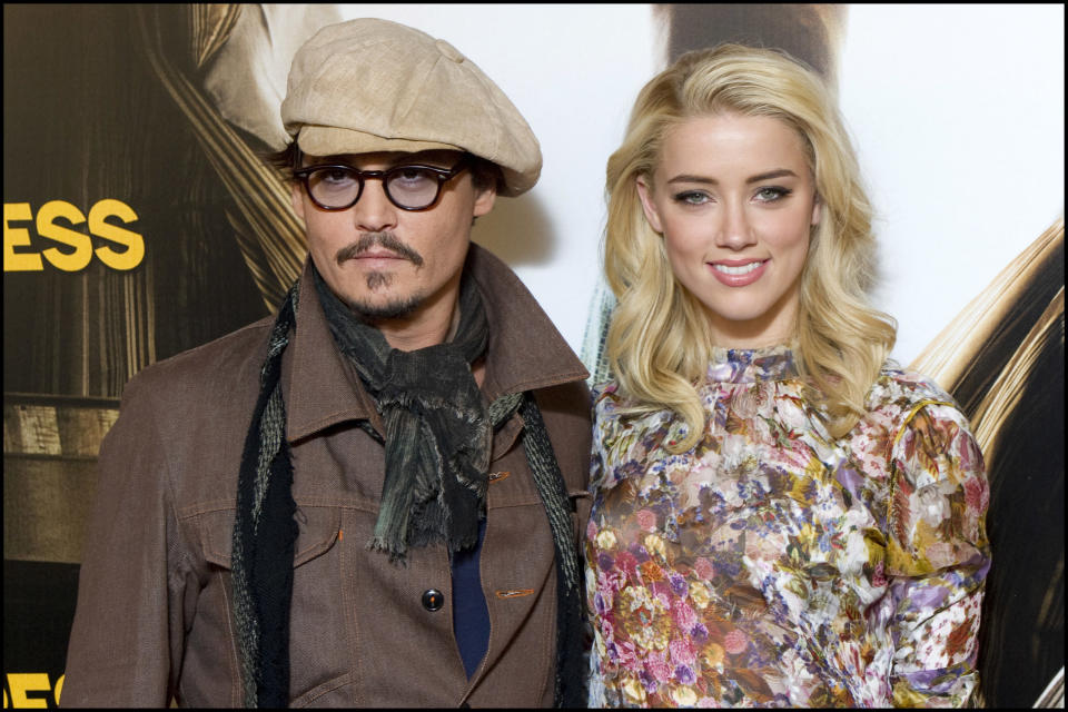 """Johnny Depp and Amber Heard attend the """"Rum Express"""" (Rum Diary) Photocall, in Paris. (Photo by Stephane Cardinale/Corbis via Getty Images)"""