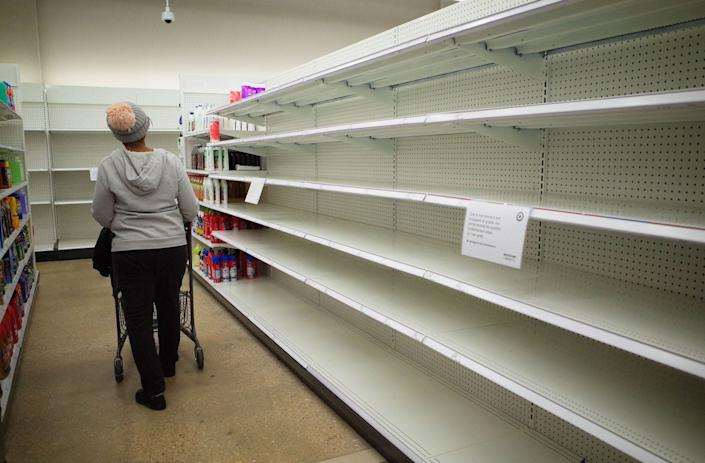 Shelves are empty of cleaning supplies at a shop in Washington, DC, on March 22.