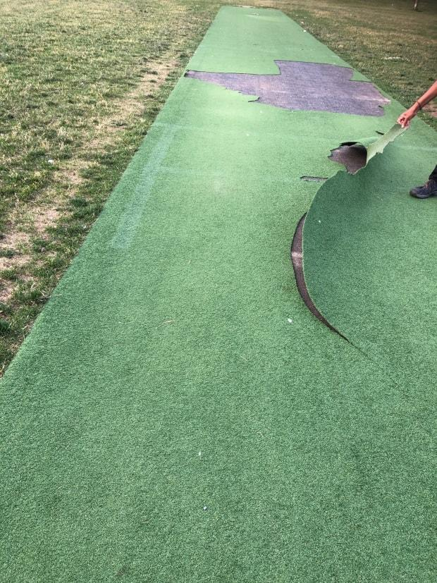 Damage done to artificial turf on a public cricket pitch in CDN-NDG means 10 cricket teams won't be able to play at Van Horne park until the borough is able to secure replacement materials and make repairs. (Raveen Nagarajah - image credit)
