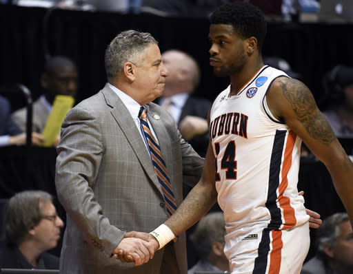 Auburn coach Bruce Pearl shakes hands with forward Anfernee McLemore (24) at the end of the team's 84-53 loss to Clemson in a second-round NCAA men's college basketball tournament game Sunday, March 18, 2018, in San Diego. (AP Photo/Denis Poroy)