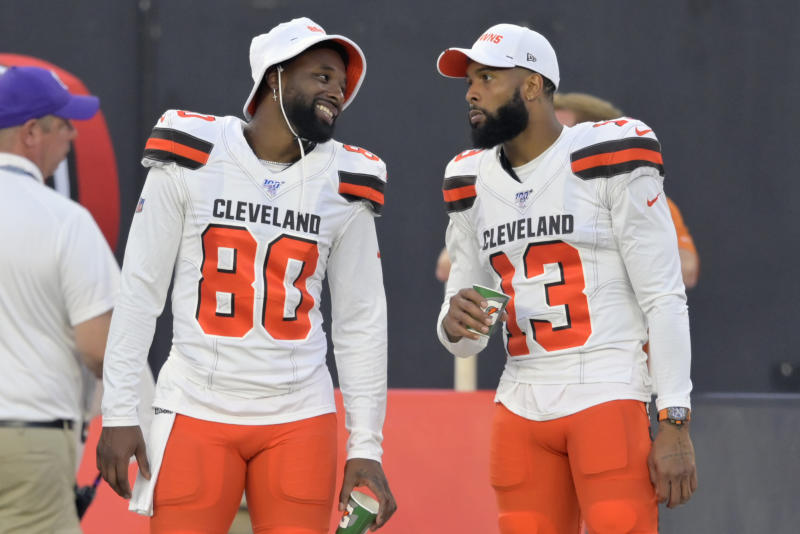 FILE - In this Aug. 8, 2019, file photo, Cleveland Browns wide receivers Jarvis Landry (80) and Odell Beckham Jr. (13) talk on the sideline during an NFL preseason football game against the Washington Redskins in Cleveland. The expansion era has been tortuous, two embarrassing decades of despair and dysfunction. Well, those painful days appear to be ending. (AP Photo/David Richard, File)