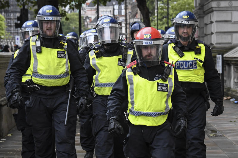 Police scuffle with demonstrators at a Black Lives Matter march in London, Saturday, June 6, 2020, as people protest against the killing of George Floyd by police officers in Minneapolis, USA. Floyd, a black man, died after he was restrained by Minneapolis police while in custody on May 25 in Minnesota. (AP Photo/Alberto Pezzali)