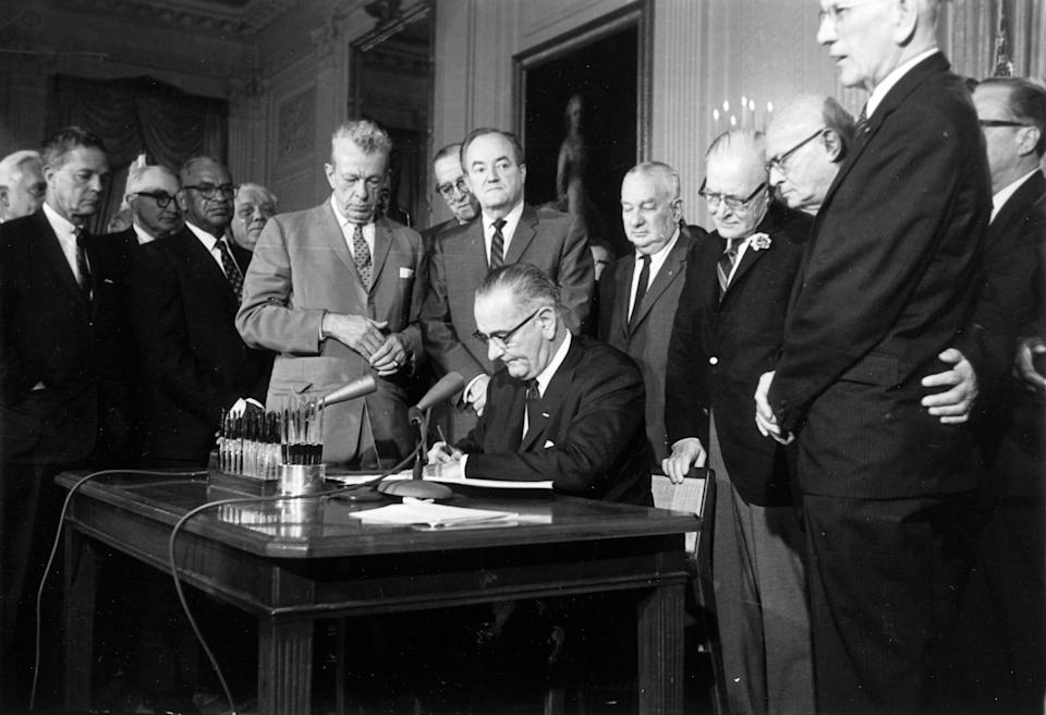 President Lyndon Johnson signs the Civil Rights Act in the East Room of the White House in Washington on July 2, 1964.