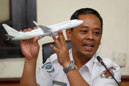 FILE PHOTO: Indonesia's National Transportation Safety Committee (KNKT) sub-committee head for air accidents, Nurcahyo Utomo, holds a model airplane while speaking during a news conference on its investigation into a Lion Air plane crash last month, in Jakarta, Indonesia November 28, 2018. REUTERS/Darren Whiteside/File Photo