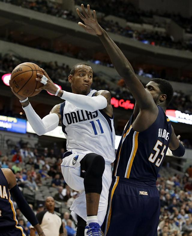 Dallas Mavericks point guard Monta Ellis (11) passes the ball as Indiana Pacers' Roy Hibbert (55) defends in the first half of a preseason NBA basketball game, Friday, Oct. 25, 2013, in Dallas. (AP Photo/Tony Gutierrez)