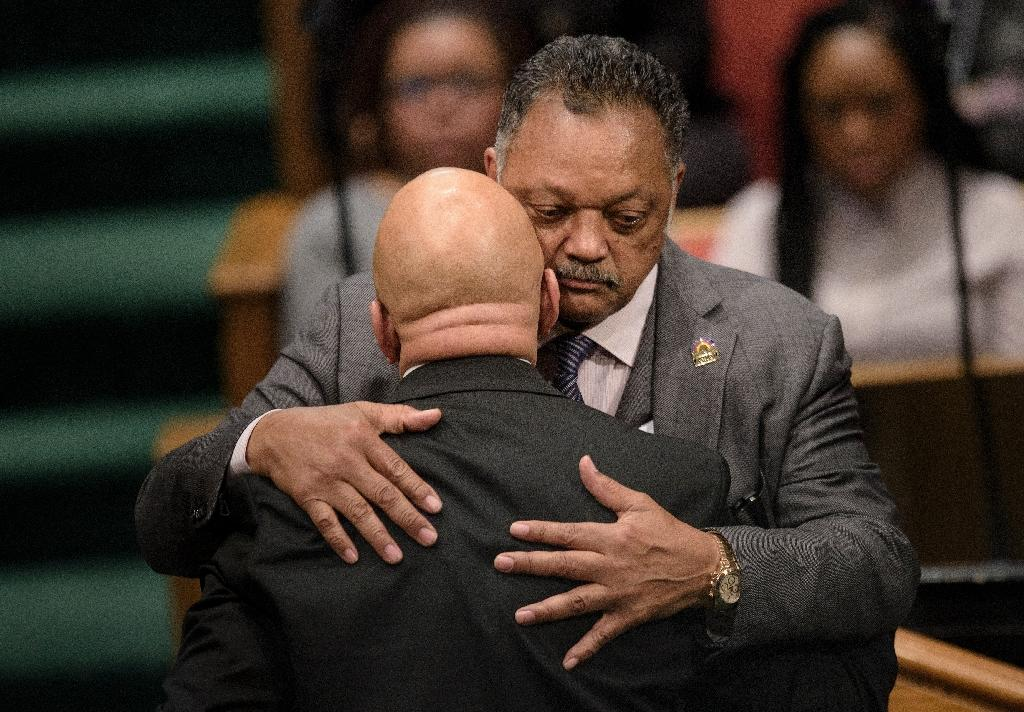 Rep. Elijah Cummings is hugged by Reverend Jesse Jackson (R) during Freddie Gray's funeral at New Shiloh Baptist Church April 27, 2015 in Baltimore, Maryland (AFP Photo/Brendan Smialowski)
