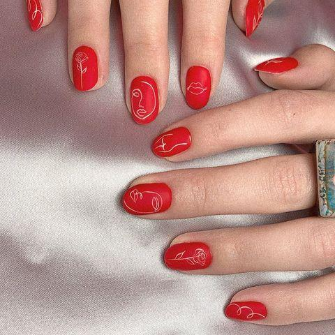 """<p>A matte red manicure looks way cooler with the addition of abstract silhouettes. </p><p><a href=""""https://www.instagram.com/p/B4FQT5RqLyZ/"""" rel=""""nofollow noopener"""" target=""""_blank"""" data-ylk=""""slk:See the original post on Instagram"""" class=""""link rapid-noclick-resp"""">See the original post on Instagram</a></p>"""