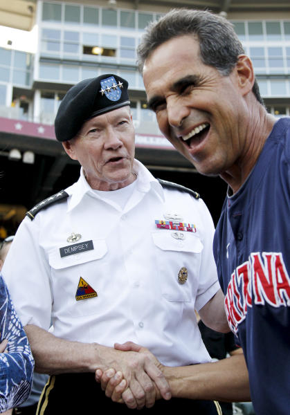 Army Gen. Martin Dempsey, chairman of the Joint Chiefs of Staff, left, meets with Arizona coach Andy Lopez at TD Ameritrade Park ahead of Game 2 of the NCAA College World Series baseball finals against South Carolina in Omaha, Neb., Monday, June 25, 2012. (AP Photo/Nati Harnik)