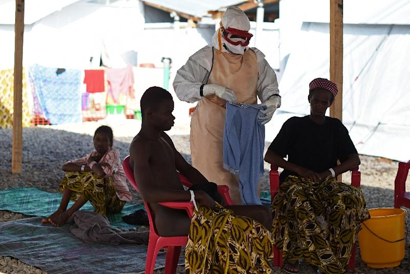 A health worker is seen assisting Ebola patients at the Kenama treatment centre in Sierra Leone, in November 2014