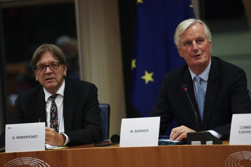 European Union chief Brexit negotiator Michel Barnier, right, sits next to European Parliament Brexit chief Guy Verhofstadt during a Brexit Steering Group meeting at the European Parliament in Brussels, Wednesday, Oct. 16, 2019. (AP Photo/Francisco Seco)
