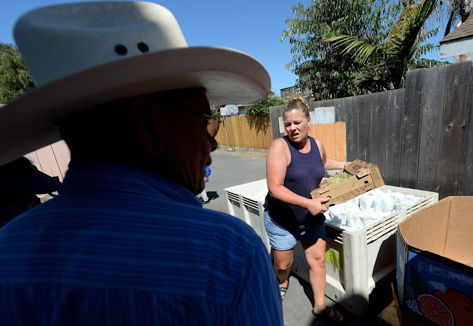 Volunteers at a monthly clandestine food distribution held by the Center for Farmworker Families in Santa Cruz County, California, in August 2019.