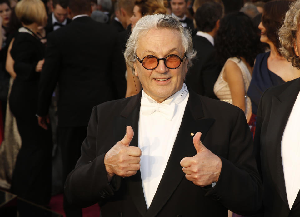 """Australian director George Miller, nominated for Best Director for his film """"Mad Max: Fury Road"""", gives two thumbs up as he arrives at the 88th Academy Awards in Hollywood, California February 28, 2016.   REUTERS/Lucas Jackson"""