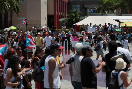 Students of the University of Puerto Rico protest as a meeting of the Financial Oversight and Management Board for Puerto Rico is taking place at the Convention Center in San Juan, Puerto Rico March 31, 2017. Picture taken March 31, 2017. REUTERS/Alvin Baez