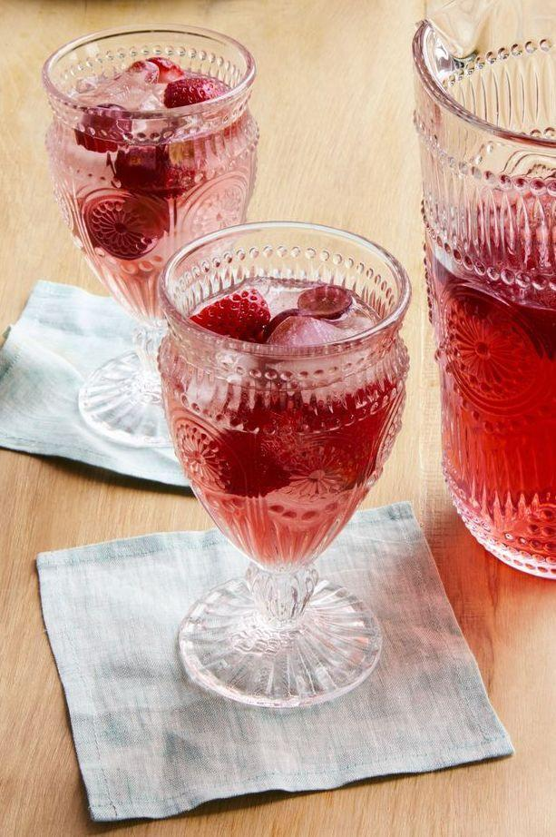 """<p>If you're a fan of rosé wine, you'll love this pink sangria. Add some fresh blueberries to the mix and you'll have the perfect Fourth of July drink. </p><p><a href=""""https://www.thepioneerwoman.com/food-cooking/recipes/a32304366/strawberry-sangria-recipe/"""" rel=""""nofollow noopener"""" target=""""_blank"""" data-ylk=""""slk:Get Ree's recipe."""" class=""""link rapid-noclick-resp""""><strong>Get Ree's recipe.</strong></a></p><p><a class=""""link rapid-noclick-resp"""" href=""""https://go.redirectingat.com?id=74968X1596630&url=https%3A%2F%2Fwww.walmart.com%2Fsearch%2F%3Fquery%3Dwine%2Bopener&sref=https%3A%2F%2Fwww.thepioneerwoman.com%2Ffood-cooking%2Fmeals-menus%2Fg36432840%2Ffourth-of-july-drinks%2F"""" rel=""""nofollow noopener"""" target=""""_blank"""" data-ylk=""""slk:SHOP WINE OPENERS"""">SHOP WINE OPENERS</a></p>"""