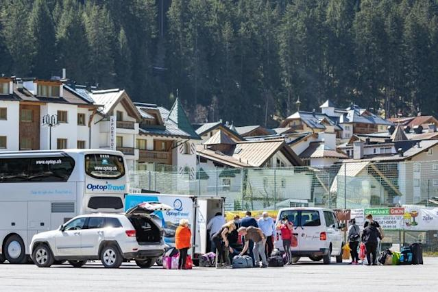 Seasonal workers get ready to leave the village of Ischgl, a tourism hotspot, after the quarantine ordered for western Tyrol, Austria's worst hit region by the new coronavirus (AFP Photo/Johann GRODER)