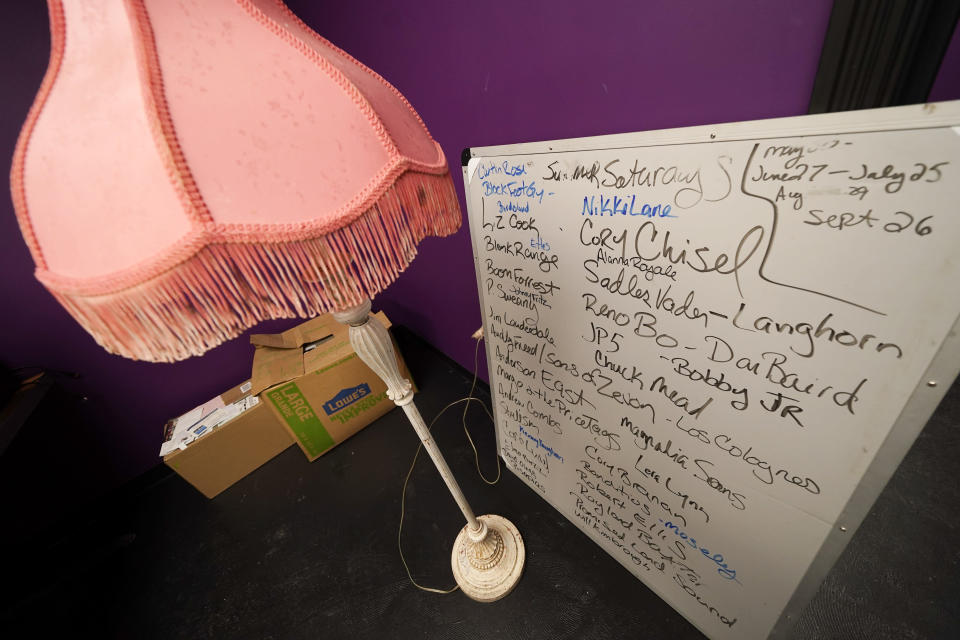 A board with names of music acts sits in a room with other items to be put back in place as work is done to rebuild The Basement East, a live music venue, Feb. 25, 2021, in Nashville, Tenn. The building was destroyed by a tornado March 3, 2020, and the difficulties of reopening were compounded by COVID-19. Now, as the anniversary of the two catastrophic events approaches, the owners hope to reopen their doors, this time with masks and tables spread out throughout their 5,000 square foot space. (AP Photo/Mark Humphrey)