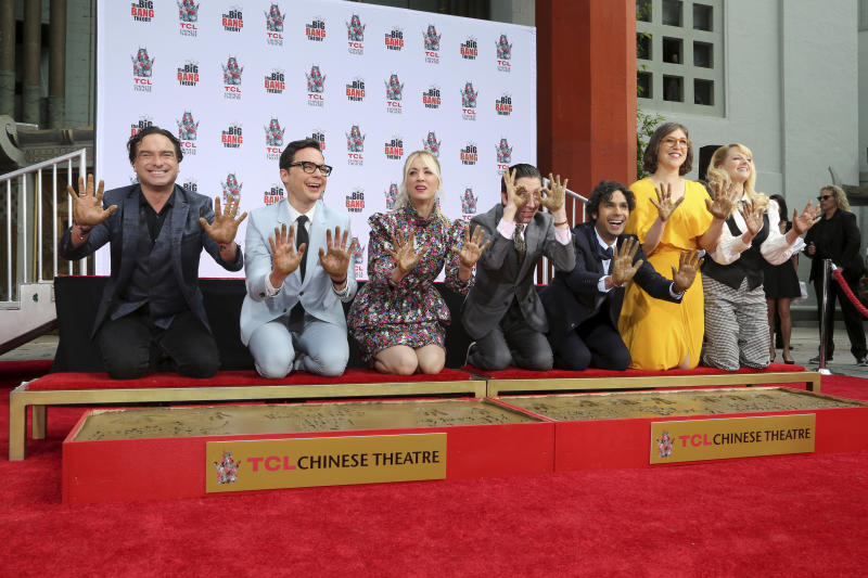 "Johnny Galecki, from left, Jim Parsons, Kaley Cuoco, Simon Helberg, Kunal Nayyar, Mayim Bialik and Melissa Rauch members of the cast of the TV series ""The Big Bang Theory,"" show their hands after placing them in cement during a hand and footprint ceremony at the TCL Chinese Theatre on Wednesday, May 1, 2019 at in Los Angeles. (Photo by Willy Sanjuan/Invision/AP)"