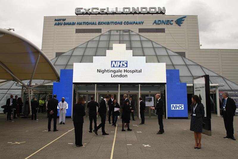 File photo dated 3/4/2020 of NHS staff gathering ahead of the opening of the NHS Nightingale Hospital at the ExCel centre in London. The ExCel centre has U-turned on charging the NHS to turn the exhibition space into a 4,000-bed field hospital.