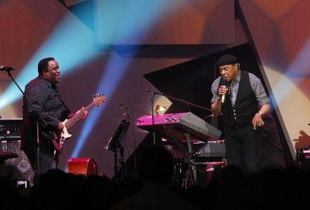 FILE PHOTO - Jazz singer Al Jarreau (R) performs during the three-day Java Jazz Festival in Jakarta March 2, 2012. About a hundred International bands and local musicians are performing in Jakarta during the event. REUTERS/Supri