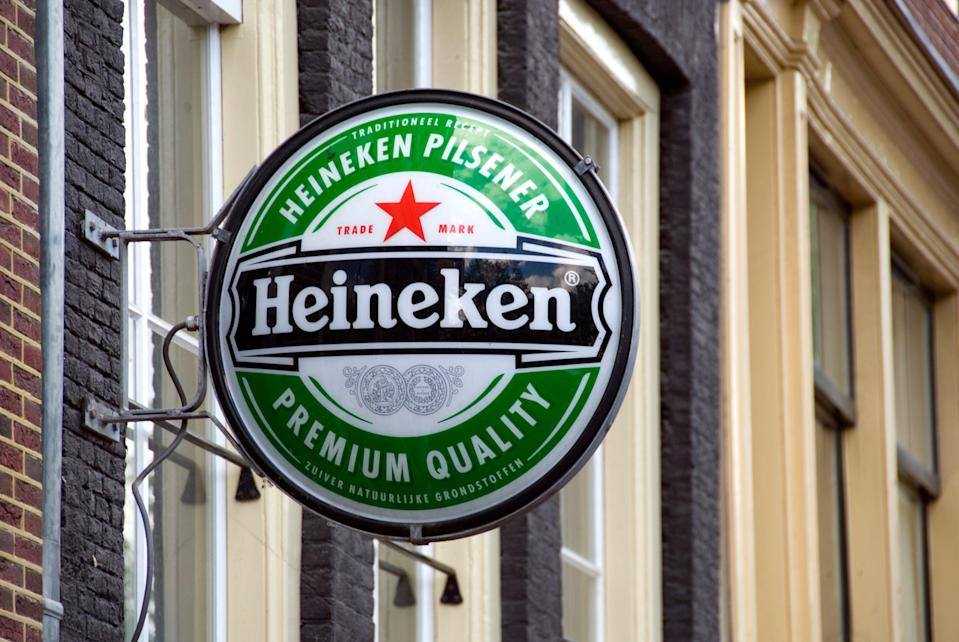 <p>The Dutch brewer said it will axe almost 10 per cent of its 85,000 staff as part of its efforts to save £1.75bn</p> (Getty)