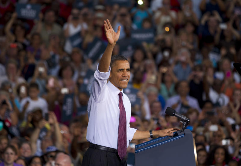 President Barack Obama greets the crowd after arriving for a campaign stop at Loudoun County High School on Thursday, Aug. 2, 2012 in Leesburg, Va. (AP Photo/Evan Vucci)