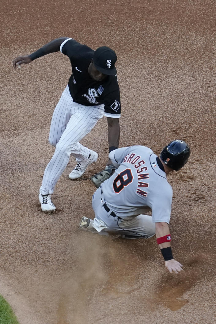 Chicago White Sox shortstop Tim Anderson, left, tags out Detroit Tigers' Robbie Grossman at second on an attempted steal during the first inning of a baseball game in Chicago, Thursday, June 3, 2021. (AP Photo/Nam Y. Huh)