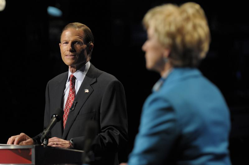 Democratic candidate for U.S. Senate Richard Blumenthal, left, and Republican candidate for U.S. Senate Linda McMahon, right, debate in Hartford, Conn., on Monday, Oct. 4, 2010. (AP Photo/Rich Messina, Pool)