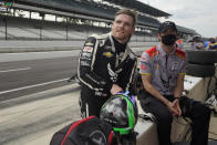 Conor Daly talks with his crew during practice for the Indianapolis 500 auto race at Indianapolis Motor Speedway, Wednesday, May 19, 2021, in Indianapolis. (AP Photo/Darron Cummings)