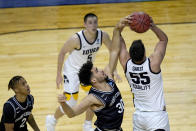 Grand Canyon's Gabe McGlothan (30) gets a hand on the shot of Iowa's Luka Garza (55) as Chance McMillian (2) and CJ Fredrick watch during the first half of a first round NCAA college basketball tournament game Saturday, March 20, 2021, at the Indiana Farmers Coliseum in Indianapolis. (AP Photo/Charles Rex Arbogast)