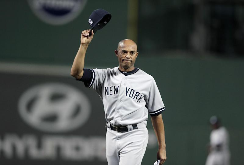 New York Yankees relief pitcher Mariano Rivera tips his hat to the crowd following a tribute honoring before the start of a baseball game against the Boston Red Sox at Fenway Park, in Boston, Sunday, Sept. 15, 2013. (AP Photo/Steven Senne)