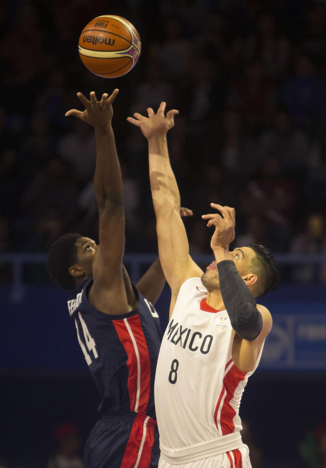 Mexico's Gustavo Ayon, right, jumps for the ball with U.S. player Smile Jefferson during the first quarter of a FIBA basketball World Cup qualifier in Mexico City, Thursday, June 28, 2018. (AP Photo/Christian Palma)
