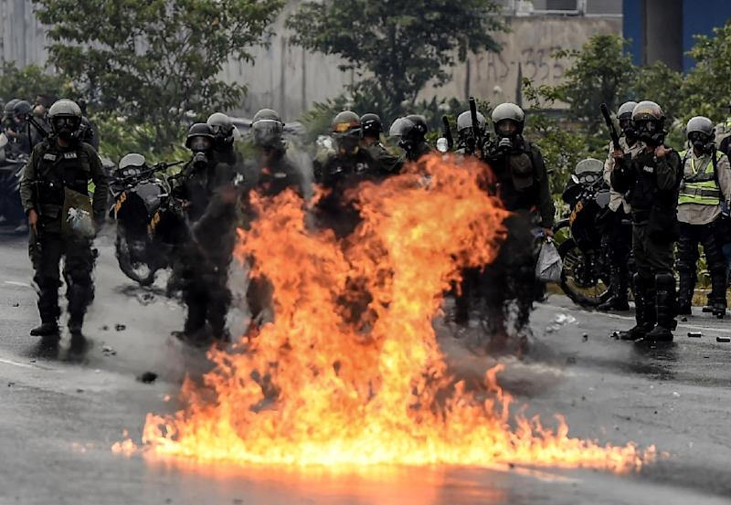 The Venezuelan National Guard stands guard as they clash with opposition activists clash in Caracas on April 13, 2017