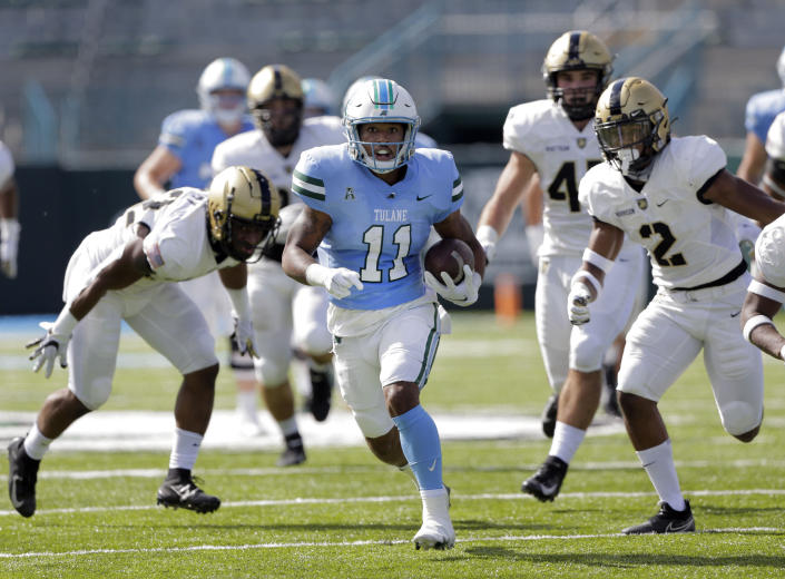 Tulane running back Amare Jones (11) goes for 50 yards against the Army during an NCAA college football game in New Orleans, La., Saturday, Nov. 14, 2020. (A. J. Sisco/The Advocate via AP)