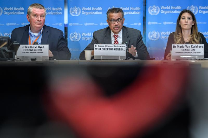 EDITORS NOTE: Graphic content / (From L) World Health Organization (WHO) Health Emergencies Programme Director Michael Ryan, WHO Director-General Tedros Adhanom Ghebreyesus and WHO Technical Lead Maria Van Kerkhove attend a daily press briefing on COVID-19 virus at the WHO headquaters in Geneva on March 11, 2020. - WHO Director-General Tedros Adhanom Ghebreyesus announced on March 11, 2020 that the new coronavirus outbreak can now be characterised as a pandemic. (Photo by Fabrice COFFRINI / AFP) (Photo by FABRICE COFFRINI/AFP via Getty Images)