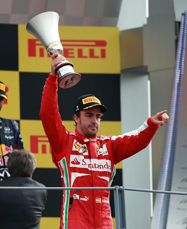 Ferrari's Fernando Alonso celebrates on the podium after the Italian Grand Prix and the Autodromo Nazionale Monza, Monza, Italy.