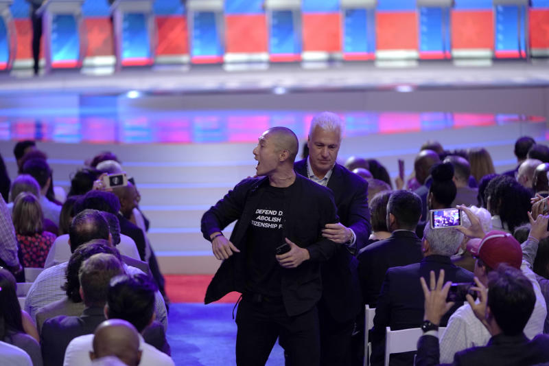A protester at the Democratic presidential primary debate
