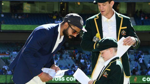 Archie Schiller, co-captain of Australia exchanging Team sheets with Virat Kohli during the toss at Boxing Day Test match