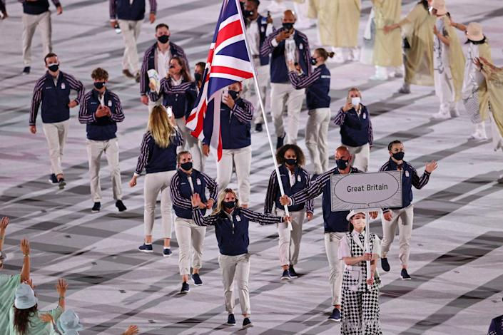 Flag bearers Hannah Mills and Mohamed Sbihi of Team Great Britain lead their team out during the Opening Ceremony of the Tokyo 2020 Olympic Games at Olympic Stadium