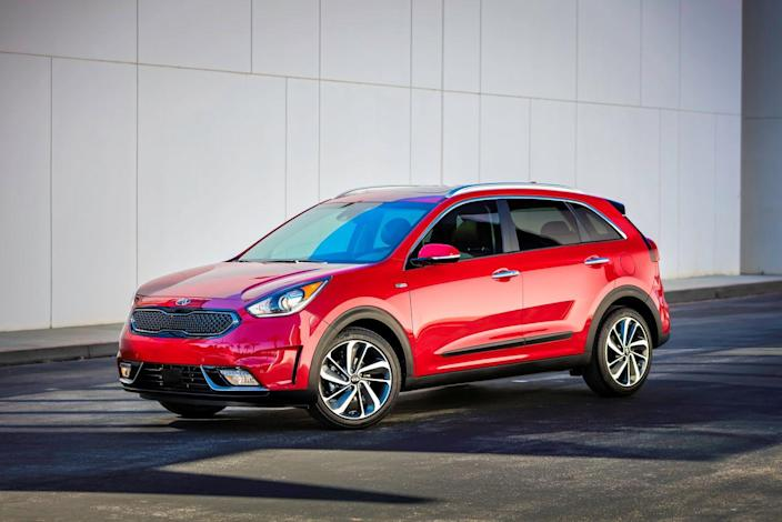 """<p>Kia is really onto something with <a href=""""https://www.caranddriver.com/kia/niro"""" rel=""""nofollow noopener"""" target=""""_blank"""" data-ylk=""""slk:its Niro hybrid"""" class=""""link rapid-noclick-resp"""">its Niro hybrid</a>: With its tall, compact-wagon–like body, it resembles a crossover. (Kia says the Niro is a crossover, but we disagree—it is only available with front-wheel drive.) In any case, the appealingly packaged and nicely priced Niro is both practical and fuel efficient. In FE trim, it'll return up to 50 mpg while still offering solid cargo space and an elevated driving position. Opt for the more feature-rich LX and EX trims, and fuel economy suffers slightly.<br></p>"""