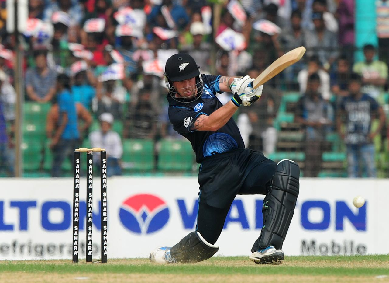 New Zealand batsman Luke Ronchi plays a shot during the third One-Day International (ODI) cricket match between Bangladesh and New Zealand at Khan Jahan Ali Stadium in Fatullah, on the outskirts of Dhaka on November 3, 2013.   AFP PHOTO/ Munir uz ZAMAN        (Photo credit should read MUNIR UZ ZAMAN/AFP/Getty Images)