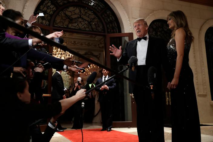 President Donald Trump speaks to reporters on Tuesday night at his Mar-a-Lago resort in Florida.