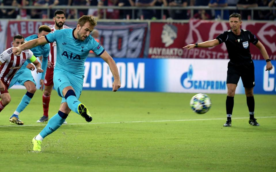 Harry Kane gives Spurs the lead. (Photo credit should read ARIS MESSINIS/AFP/Getty Images)