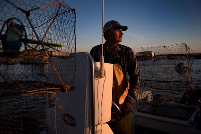<p>Mayor and waterman James Eskridge sets out to check his crab traps during the early morning in Tangier, Virginia, May 16, 2017, where climate change and rising sea levels threaten the inhabitants of the slowly sinking island.<br> (Jim Watson/AFP/Getty Images) </p>